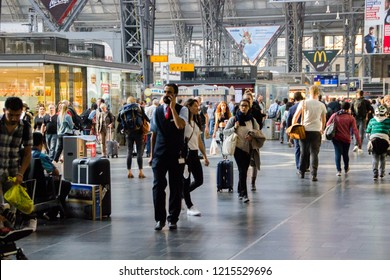 Frankfurt/ Germany - October 16 2018: Busy waiting area and corridors for travellers to get to their train platforms on a trainstation