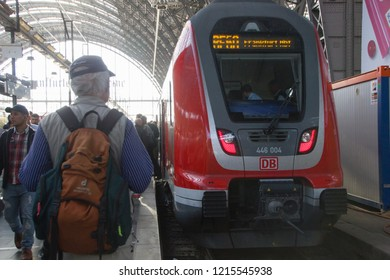 Frankfurt/ Germany - October 16 2018: Red train waggon from Deutsche Bahn company, waiting on the platform for passengers to get inside and travel to another destination.