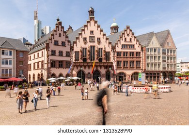 Frankfurt - Germany, Roemerberg, May 26th 2018, people walking on Frankfurt historic townhall square Roemerberg in front of the Roemer on a sunny spring day