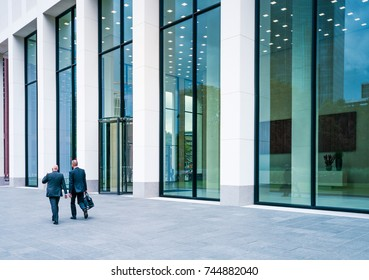 FRANKFURT, GERMANY - SEP 01, 2015: People walking to work beside a entrance of the modern building in Frankfurt, Germany