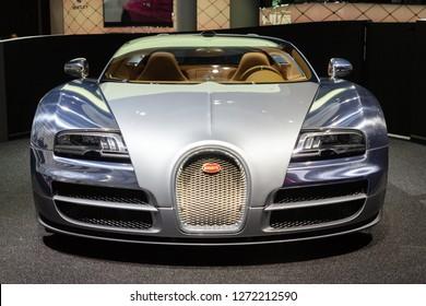 FRANKFURT, GERMANY - SEP 13, 2013: Bugatti Veyron Grand Sport LOr Blanc sports car showcased at the Frankfurt IAA Motor Show.