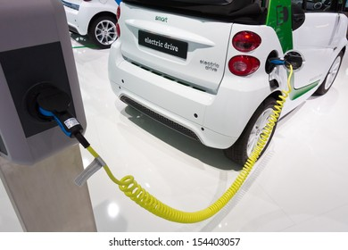 FRANKFURT, GERMANY - SEP 13: Charging a Smart Electric Drive at IAA motor show on Sep 13, 2013 in Frankfurt. More than 1.000 exhibitors from 35 countries are present at the world's largest motor show.