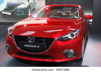 FRANKFURT, GERMANY - SEP 13: New Mazda3 at the IAA motor show on Sep 13, 2013 in Frankfurt. More than 1.000 exhibitors from 35 countries are present at the world's largest motor show.