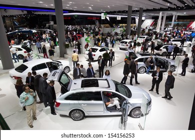 FRANKFURT, GERMANY - SEP 13: Visitors at the IAA motor show on Sep 13, 2013 in Frankfurt. More than 1.000 exhibitors from 35 countries are present at the world's largest motor show.