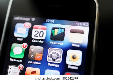 FRANKFURT, GERMANY - SEP 20, 2012: Tilt-shift lens over first Apple iPhone 2G screen with all the major Apps - Mail, calendar, notes, passbook, schedule, notes.
