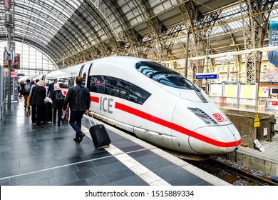 FRANKFURT, GERMANY - SEP 24, 2019: Deutsche Bahn ICE 3 train stopping at platform of Frankfurt am Main Hauptbahnhof (Central Station) with passengers boarding the train