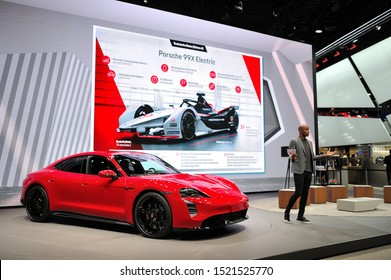 FRANKFURT, GERMANY - SEPT 2019: red PORSCHE TAYCAN TURBO S is an all-electric 4-door coupe was first unveiled as a concept car named Mission E, IAA International Motor Show Auto Exhibtion.