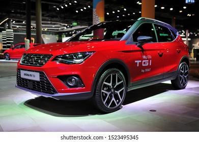 FRANKFURT, GERMANY - SEPT 2019: red SEAT ARONA FR TGI electric SUV car, IAA International Motor Show Auto Exhibtion.