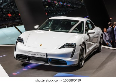 FRANKFURT, GERMANY - SEPT 2019: white PORSCHE TAYCAN TURBO S is an all-electric 4-door coupe was first unveiled as a concept car named Mission E, IAA International Motor Show Auto Exhibtion.
