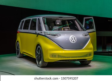 FRANKFURT, GERMANY - SEPT 2019: yellow gray VOLKSWAGEN VW I.D. BUZZ or VW Electric Microbus, is an electric minivan based on the electric MEB platform, IAA International Motor Show Auto Exhibtion.