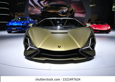 FRANKFURT, GERMANY - SEPT 2019: yellow golden LAMBORGHINI SIAN FKP 37 is a mid-engine hybrid sports car. It is the first hybrid production vehicle produced by the brand, IAA International Motor Show