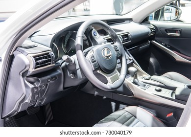 Frankfurt, Germany, September 13, 2017: metallic white LEXUS IS 300h hybrid SPORTS SALOON BOLDLY DIFFERENT at 67th International Motor Show (IAA), control board, steering wheel, upholstery, seats