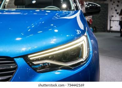Frankfurt, Germany, September 13, 2017: World premiere: metallic blue OPEL Grandland X at 67th International Motor Show (IAA), front LED headlights