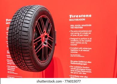 Frankfurt, Germany, September 13, 2017:  Aluminum rim with tubeless tire Firestone Multiseason at 67th International Motor Show (IAA)