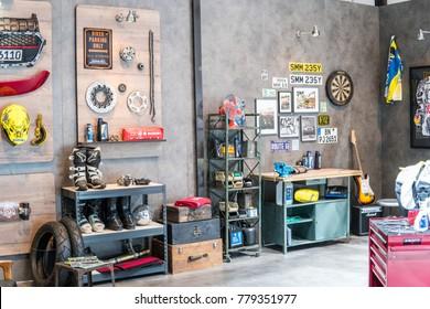 Frankfurt, Germany, September 13, 2017: Suzuki booth, car, motorcycle repair shop, old, classic, vintage style workshop at 67th International Motor Show IAA