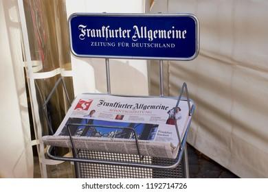 Frankfurt, Germany - September 30, 2018: Frankfurter Allgemeine Zeitung paper holder. Frankfurt General Newspaper, abbreviated FAZ, is a centre-right, liberal-conservative daily German newspaper