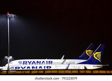 FRANKFURT HAHN,GERMANY-JANUARY 06,2018:RYANAIR Boeing 737 in the airtport at night.Ryanair- Irish low-cost airline headquartered in Swords, a suburb of Dublin, Ireland.