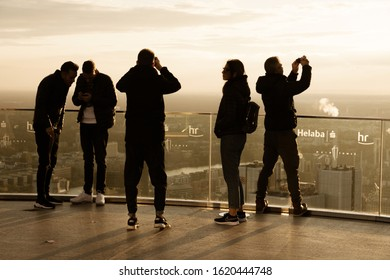 Frankfurt, Hesse / Germany - November 9. 2019five people enjoy the view and take photos of the viewing platform of the Main Tower in Frankfurt