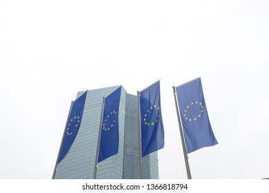 Frankfurt, Hessen / Germany - April 5 2019: New European Central Bank (ECB) headquarters building in Frankfurt Germany with European Union (EU) Flags on display.