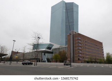 Frankfurt, Hessen / Germany - April 5 2019: New European Central Bank (ECB) headquarters building entrance in Frankfurt Germany with cars parked in front.