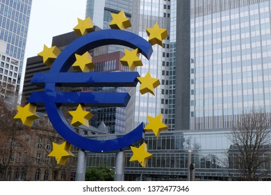 Frankfurt, Hessen / Germany - April 5 2019: Old European Central Bank (ECB) headquarters building in Frankfurt Germany with large blue Euro sign.