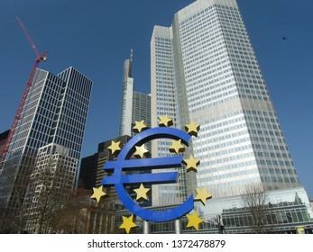 Frankfurt, Hessen / Germany - April 5 2019: Old European Central Bank (ECB) headquarters building tower skyscraper in Frankfurt Germany with large blue Euro sign.