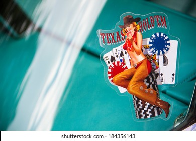 FRANKFURT - JUNE 10, 2013: Close up of a Texas Hold Em sticker on a windshield taken on June 10, 2013 in Frankfurt, Germany