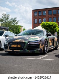 Frankfurt am Main Germany - 06 22 2019: Audi R8 with a camouflage wrap on it and a fitting license plate for car shows. Shot from a low angle.