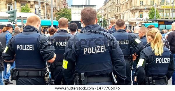 Frankfurt am Main, Germany - 15 August 2019: German Police Officers patrolling on a crowded street in Frankfurt am Main, Germany.