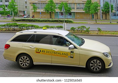 FRANKFURT AM MAIN, GERMANY -9 MAY 2018- View of a beige taxi cab on the street in Frankfurt.