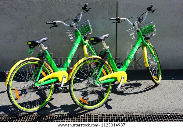 FRANKFURT AM MAIN, GERMANY -9 MAY 2018- View of green and yellow LimeBike shared bike rental bicycles on the street in Frankfurt.