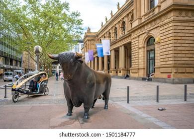 FRANKFURT AM MAIN, GERMANY - APRIL 25, 2019: Bull sculpture in front of Frankfurt Stock Exchange in Frankfurt, Germany.