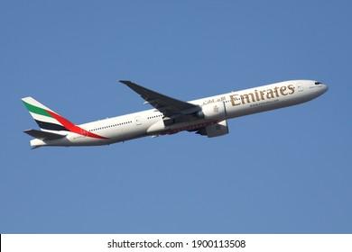 FRANKFURT AM MAIN, GERMANY - FEBRUARY 4, 2012: Emirates Boeing 777-300 with registration A6-ECQ airborne at Frankfurt Airport.
