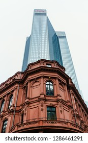 Frankfurt am Main, Germany - January 07, 2019: Trianon Tower with a historic building in front. It is a 45-story, 186 m skyscraper in the Westend-South district of Frankfurt, completed in 1993