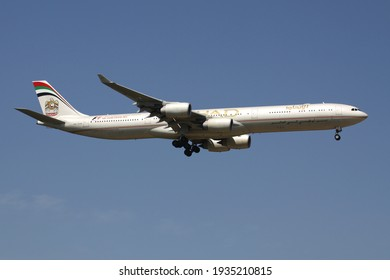 FRANKFURT AM MAIN, GERMANY - JULY 24, 2012: Etihad Airways Airbus A340-600 with registration A6-EHK on final for runway 07R of Frankfurt Airport.