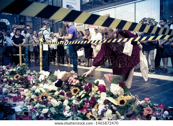 Frankfurt am Main, Germany - July 30 2019: Flowers and candles near the platform where the 8 year kid was pushed infront of an approaching ICE train.