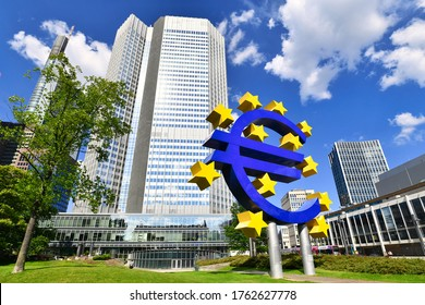 Frankfurt am Main, Germany - June 2020:  Euro sign at European Central Bank headquarters skyscraper in modern financial business district in Frankfurt city on summer day with blue sky