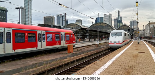 Frankfurt am Main, Germany - March 06, 2019: a train of the type ICE of the company Deutsche bahn is standing at a platform of the main railway station while a regional train is leaving