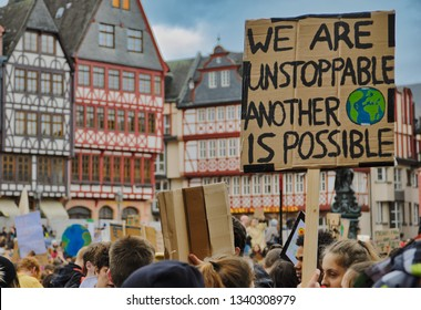 """Frankfurt am Main, Germany - March 15, 2019: """"Fridays for Future"""" protest in Frankfurt. Participants protesting against climate policy and for a better planet at the """"Römer(Rathaus)/Römerberg"""""""