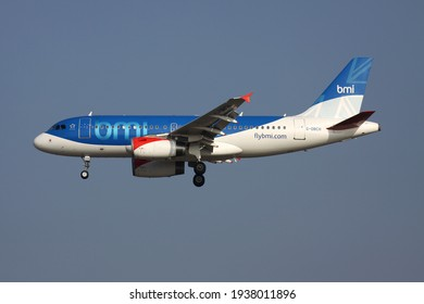 FRANKFURT AM MAIN, GERMANY - MARCH 15, 2012: British bmi Airbus A319-100 with registration G-DBCH on final for runway 25L of Frankfurt Airport.