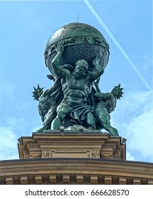 FRANKFURT AM MAIN, GERMANY - MAY 18, 2016:  Facade of Deutsche Bahn railway central station (Hauptbahnhof). Atlas God Statue
