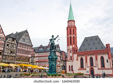 FRANKFURT AM MAIN, GERMANY - MAY 29, 2016: View of the historical center - Altstadt, Roemerberg Platz, Fountain of Justice and Old Saint Nicholas Church.