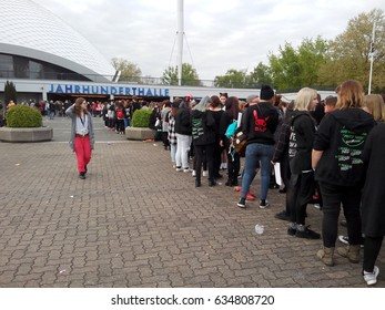 "FRANKFURT AM MAIN, GERMANY - MAY 5, 2017: German fans line up in front of  the Jahrhunderthalle for the BAP World Tour ""Party Baby!"" concert."