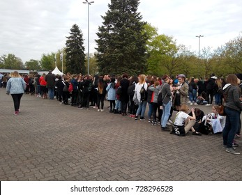 "FRANKFURT AM MAIN, GERMANY - MAY 5, 2017: German fans queuing in front of the Jahrhunderthalle for the BAP World Tour ""Party Baby!"" concert."