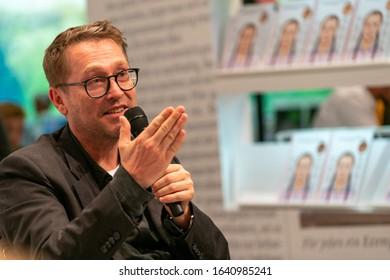 FRANKFURT AM MAIN, Germany - October 19 2019: Jan Weiler (*1967, German journalist and writer) talking on stage at 71st Frankfurt Book Fair / Buchmesse Frankfurt