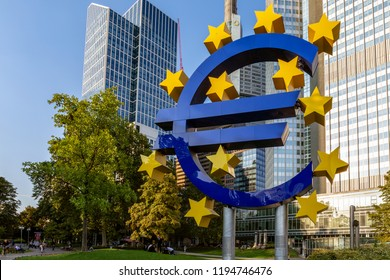 Frankfurt am Main, Germany - September 05th 2018: Euro sculpture in front of Eurotower, European Central Bank. The sculture was designed by Ottmar Hörl in the late 1990th.