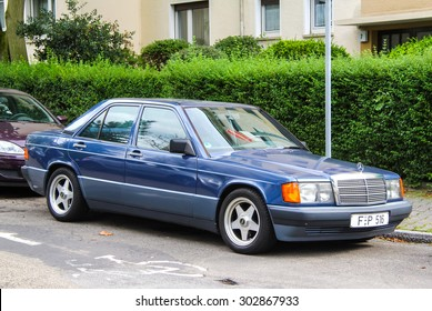 FRANKFURT AM MAIN, GERMANY - SEPTEMBER 15, 2013: Motor car Mercedes-Benz W201 190E at the city street.