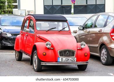 FRANKFURT AM MAIN, GERMANY - SEPTEMBER 15, 2013: Red retro car Citroen 2CV in the city street.