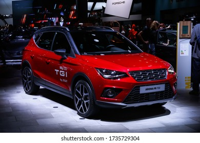 Frankfurt am Main, Germany - September 18, 2019: Bright red crossover SEAT Arona FR TGI presented at the Frankfurt International Motor Show IAA (Internationale Automobil Ausstellung).