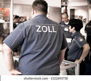 Frankfurt am Main, Germany - September 20 2019: German Customs Officers on duty at the airport in Frankfurt am Main, Germany.